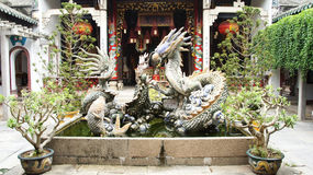 Huge dragon figure inside Chinese temple complex Stock Photo