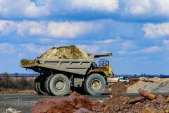 Free Huge Dump Truck Loaded With Iron Ore On A Gravel Road Stock Photo - 192944230