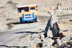 Huge dump truck transporting granite rock or iron ore Stock Images