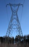Huge electricity pylon. Huge high voltage electricity in the forest stock image