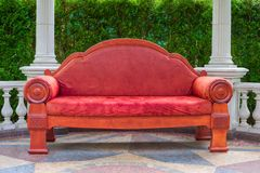 Huge empty red sofa outdoor royalty free stock photography