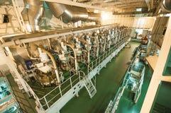 Huge engine on board extra large cargo ship. royalty free stock image