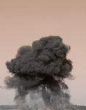 Huge Explosion. Massive mushroom cloud from huge explosion and fire