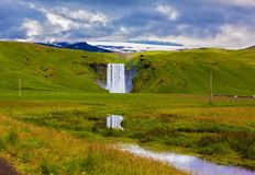The huge falls Skogafoss Stock Images