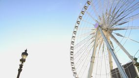 Huge Ferris wheel against blue sky background, beautiful sunny day in theme park. Stock footage stock footage