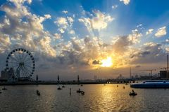 Ferris Wheel under Dramatic Sunrise and Sunset and cloudy sky, Nature background with strong sunbeam, Hope concept. Huge Ferris Wheel under Dramatic Sunrise and royalty free stock photo