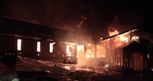 Huge fire blazing in commercial building. Winter condition stock footage