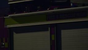 A huge fire rescue truck. A medium pan to right establishing shot of a fire truck stock video