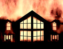 House fire. Huge flames ungulfing a house Stock Image