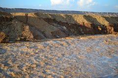 Huge Flash flood in Mitzpe Ramon Crater, Negev desert in South Israel, streams floods of water in the desert wilderness stock images