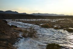 Huge Flash flood in Mitzpe Ramon Crater, Negev desert in South Israel, streams floods of water in the desert wilderness. Flash flood in Mitzpe Ramon Crater stock photography