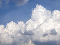 Huge fluffy cloud on blue sky Royalty Free Stock Photos
