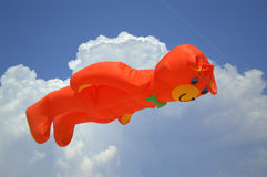 Huge flying orange bear kite Stock Photos