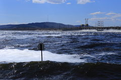 A huge force of water and the nature at the dam Royalty Free Stock Photos
