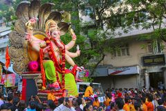 Huge Ganapati idol, decorated with snakeheads carried on truck with devotees. Mumbai Stock Photos