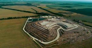 Huge garbage dump in the field. A huge garbage dump a pyramid of garbage stock footage