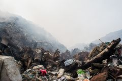 Huge garbage dump mountains view full of litter, plastic bottles,rubbish and other trash at the Thilafushi tropical island. Huge garbage dump mountains view Stock Image