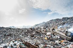 Huge garbage dump view full of litter,plastic bottles,rubbish and other trash at the Thilafushi tropical island. In Maldives Stock Image