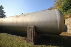 Huge gas storage tanks in an industrial area. Large cylinders are used to capture gas during energy crises or supply problems Royalty Free Stock Images