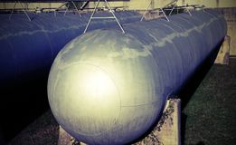 Huge gas storage tanks in an industrial area. Large cylinders are used to capture gas during energy crises or supply problems Royalty Free Stock Image