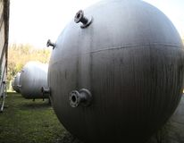 Huge gas storage tanks in an industrial area. Large cylinders are used to capture gas during energy crises or supply problems Stock Photography