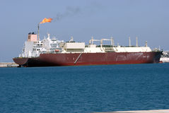 Huge Gas Tanker. A Tanker loading natural gas Royalty Free Stock Photo