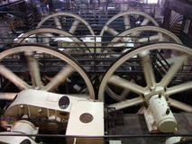 Huge GE engines and winding wheels that pull the cables inside Royalty Free Stock Photography