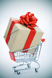 Huge gift in a shopping cart Stock Image