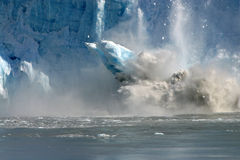 Huge Glacier chunk falling Stock Photo