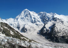 Huge glacier, snow and high rocky peaks of Caucasian mountains Royalty Free Stock Images