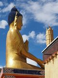 A huge golden figure Buddha of Matreya on a high pedestal, view in profile, vertical frame, the monastery of Likir Gonpa, Ladakh, Stock Images