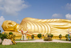 Huge golden sleeping Buddha with blue sky. At Songkhla Thailand royalty free stock photos