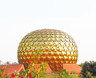 Huge golden spherical ball auroville tamil nadu india Royalty Free Stock Photos