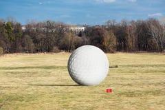 Huge golf ball Stock Photography