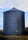 Huge Grain Bin. Huge metal grain storage bin standing in eastern Oregon Royalty Free Stock Images