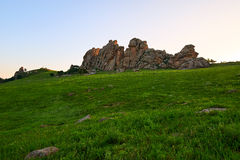 The huge granite on the alpine meadow sunset Stock Photography