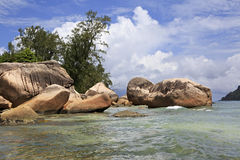 Huge granite boulders on the beach Anse Boudin Stock Photography