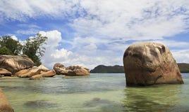 Huge granite boulders on the beach Anse Boudin Stock Photo