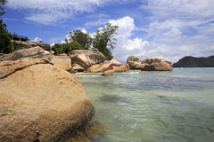 Huge granite boulders on the beach Anse Boudin Royalty Free Stock Photo