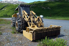 A huge grass cutter used in alaska to trim brush from the roadside Royalty Free Stock Photos