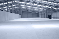 Huge gray and light warehouse with metal roof Stock Photo