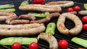 A huge grill on which aesthetically laid out roasted sausages, sweet peppers, vegetables, chicken meat.Street Food, Fast. Food, Snack on the street, delicious stock video footage