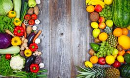 Free Huge Group Of Fresh Vegetables And Fruit On Wooden Background - Vegetables VS Fruit - High Quality Studio Shot Royalty Free Stock Images - 147139769