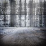 Huge Grungy Concrete Room. With weathered and distressed walls Royalty Free Stock Photography