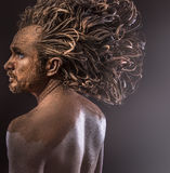 Huge hair, wild man, tribal concept, traditions, body covered wi. Th mud,cool Stock Images
