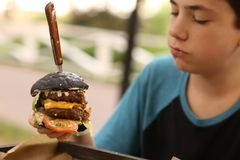 Huge hamburger burger with cheese beef tomato royalty free stock image