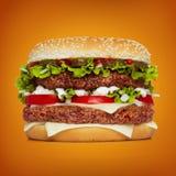 Huge hamburger over orange background Stock Image