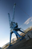 Huge harbor crane with blue sky. Port crane in Linz, Austria. Huge crane used to clear ships to boxcars at the Danube river. Although a still life very dynamic Stock Photography