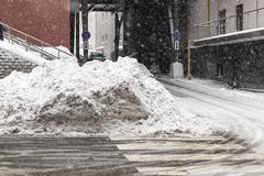 Huge heap of dirty snow and ice on a city street. Collected after heavy snowfall Royalty Free Stock Photo