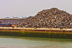 Huge heap of scrap metal on dockside Royalty Free Stock Image